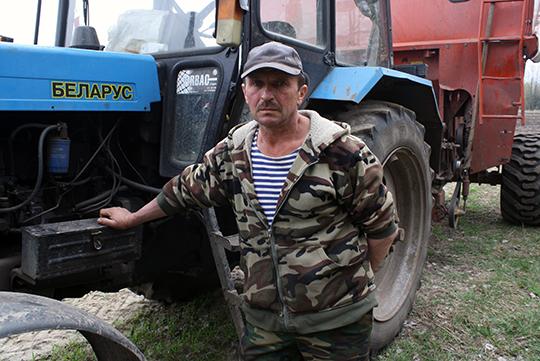 На загрузцы збожжа – механізатар Аляксей Амельчанка